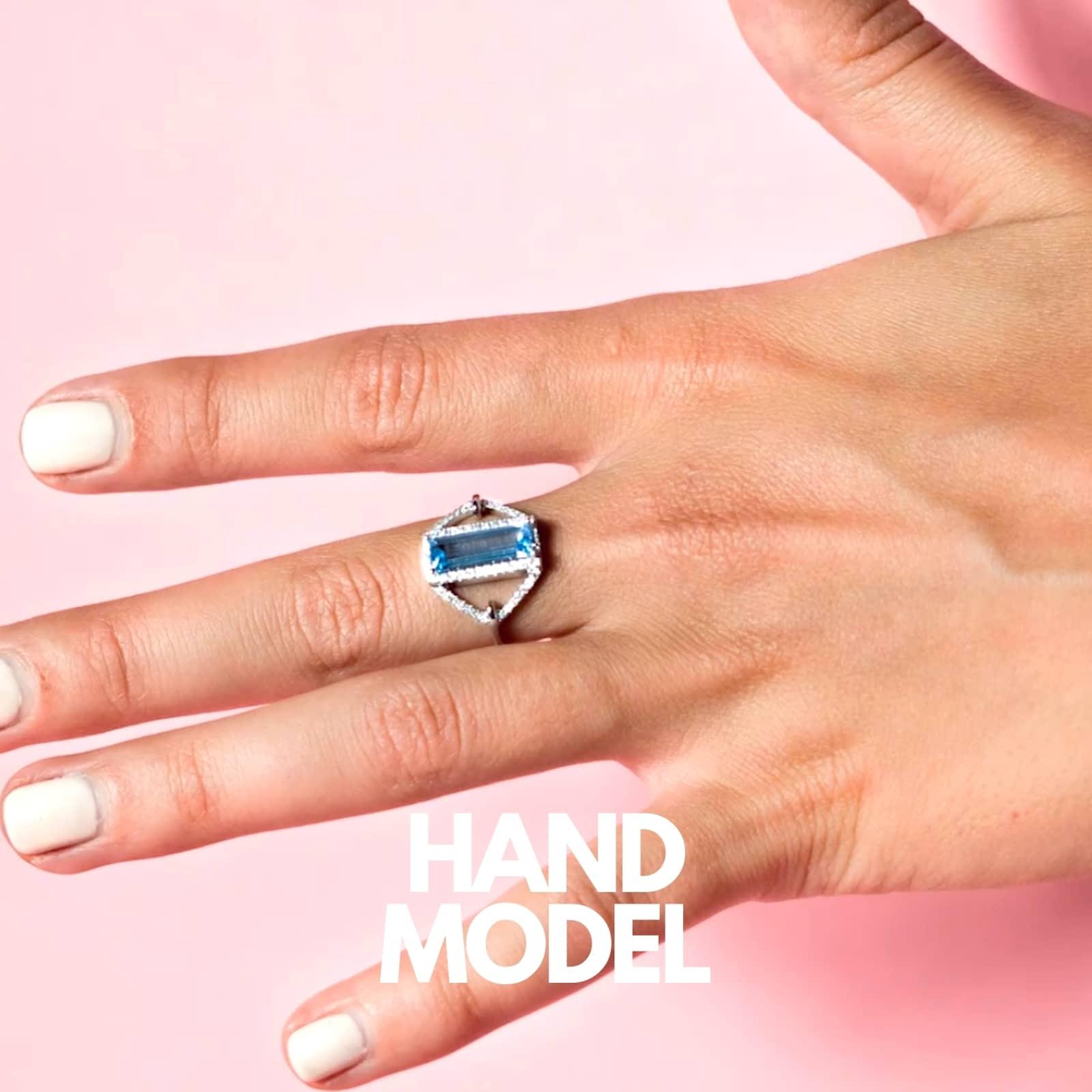 Hand Model demonstrating wearing a blue ring on her long finger