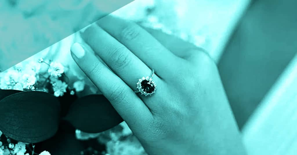 Green Colored Engagement Ring with Diamonds on women's hand