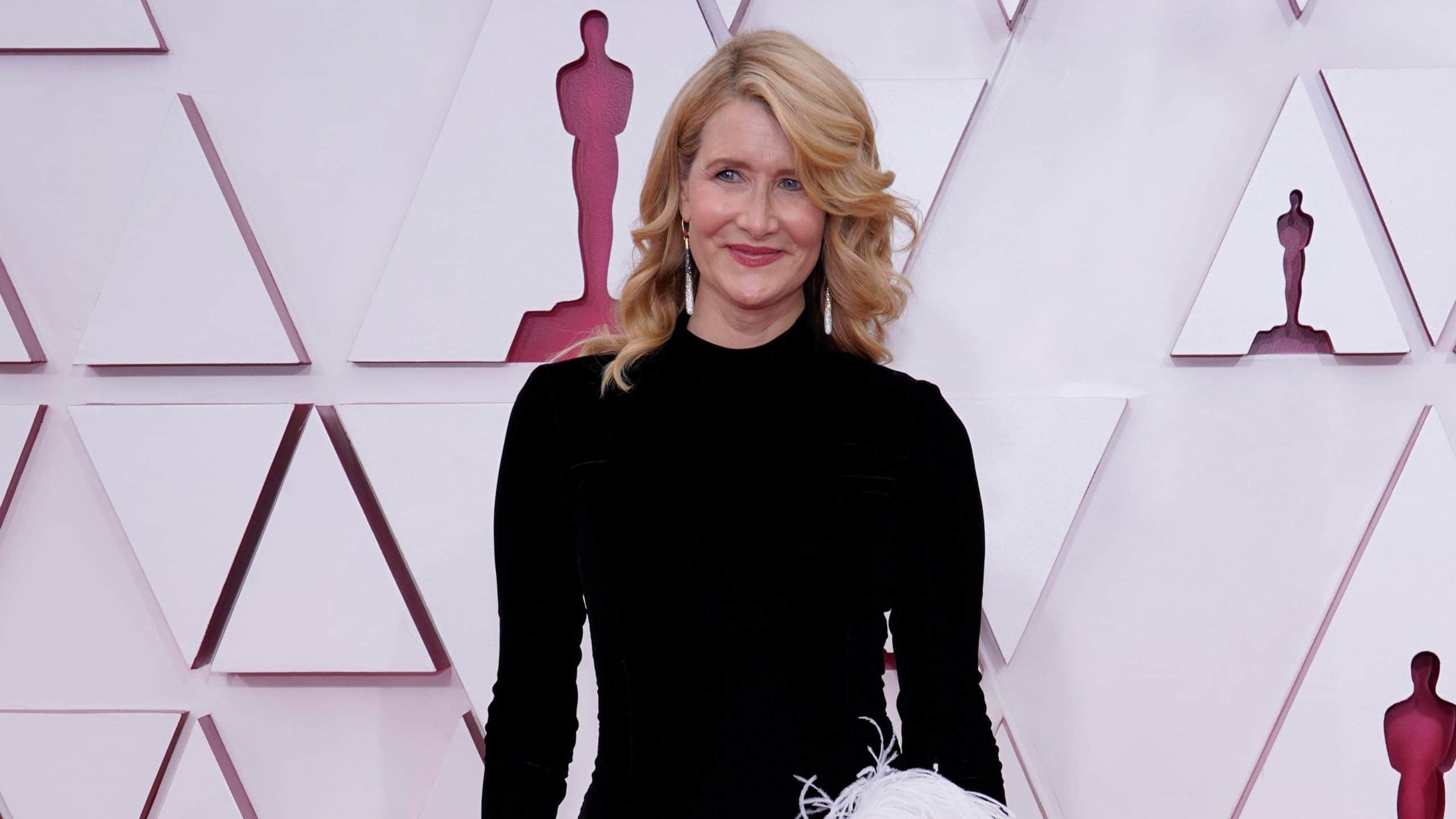 Laura Dern wearing diamond earrings and a black dress at the 2021 Oscars