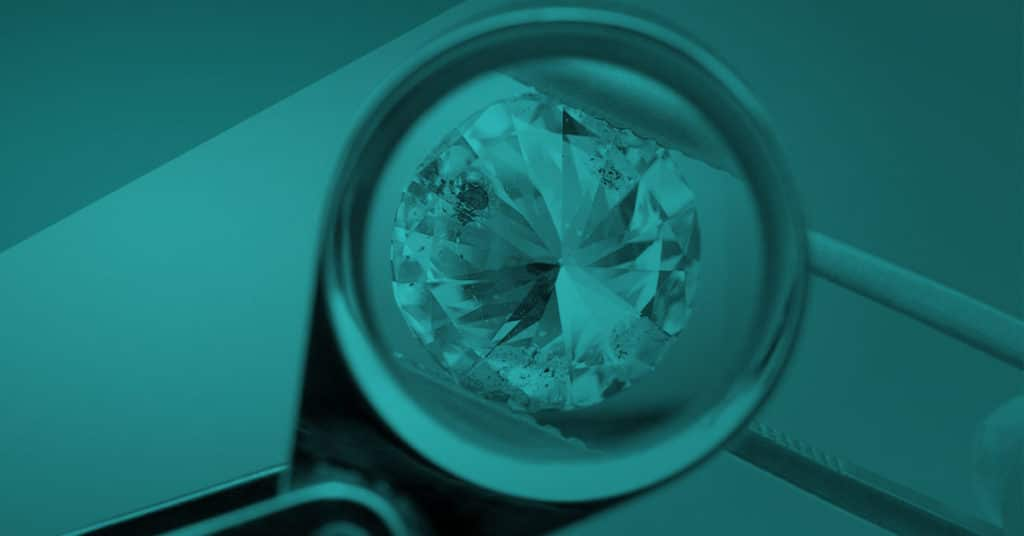 Examining a diamond using a Jeweler's Loupe