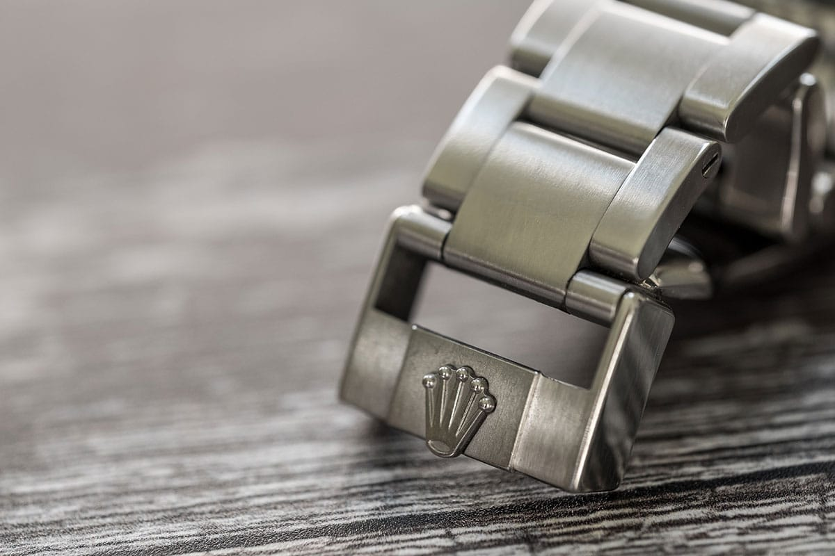 close-up of links of a Rolex watch