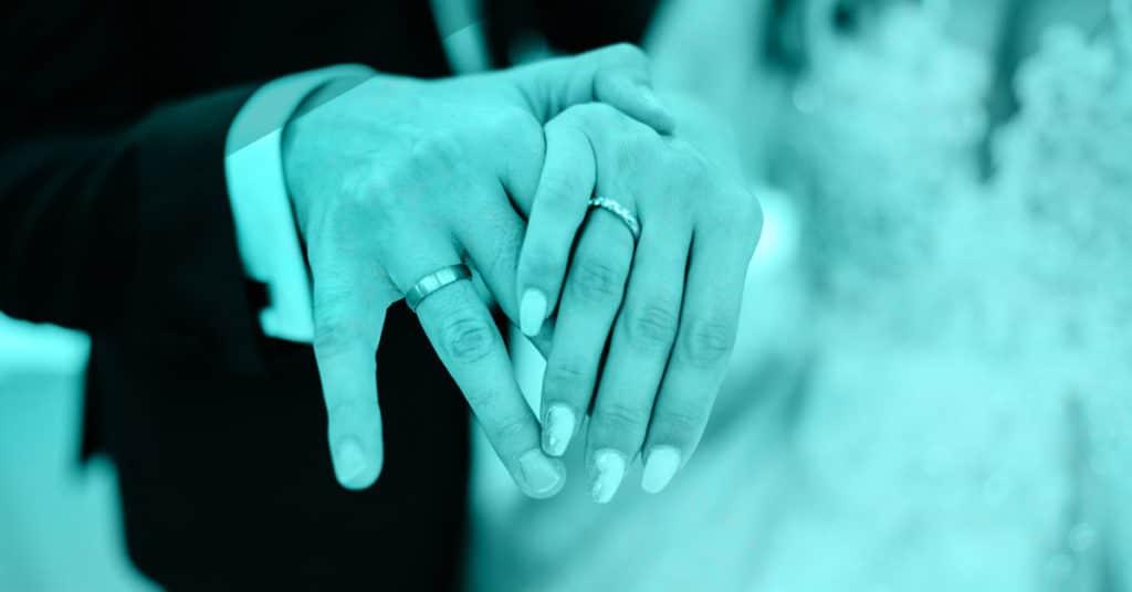 Showing off wedding rings at wedding