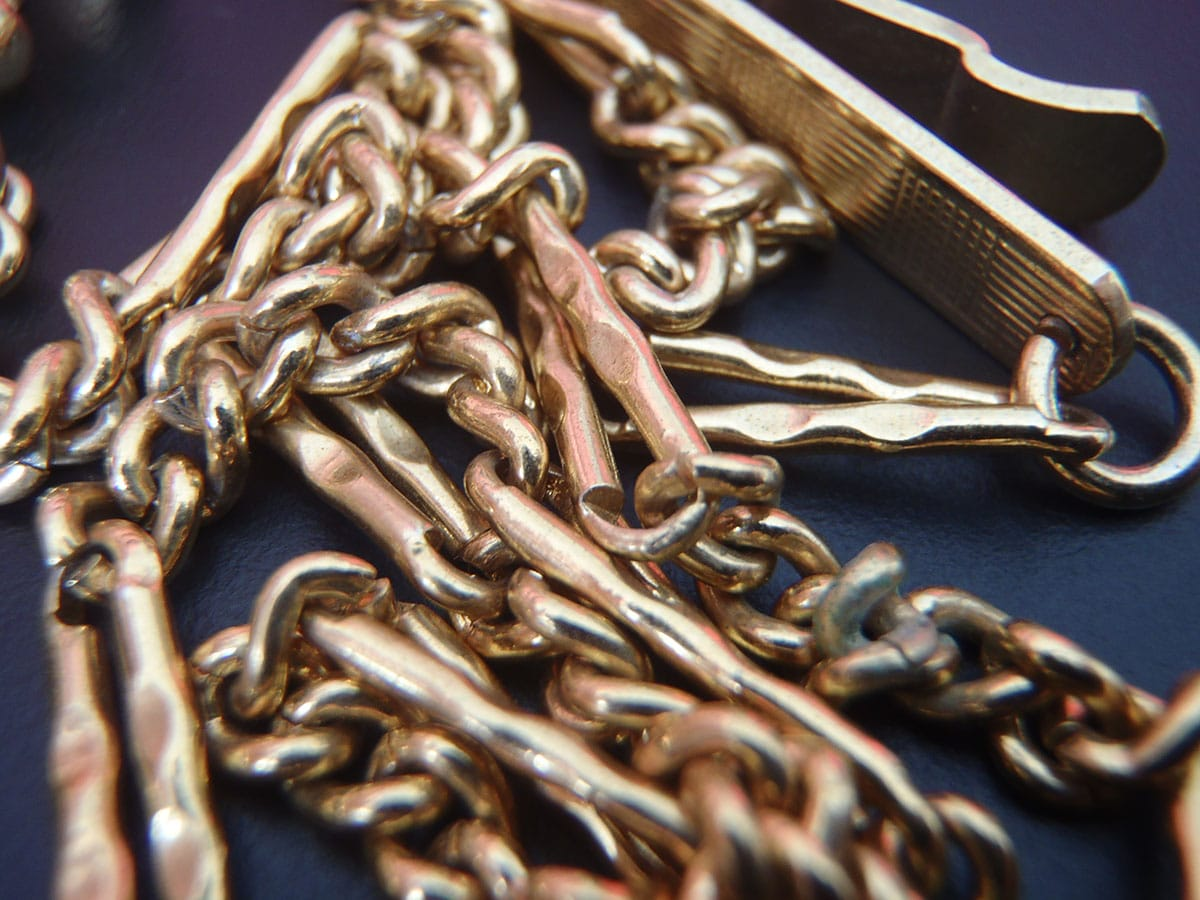 Two antique watch fob chains joined together to form a longer chain