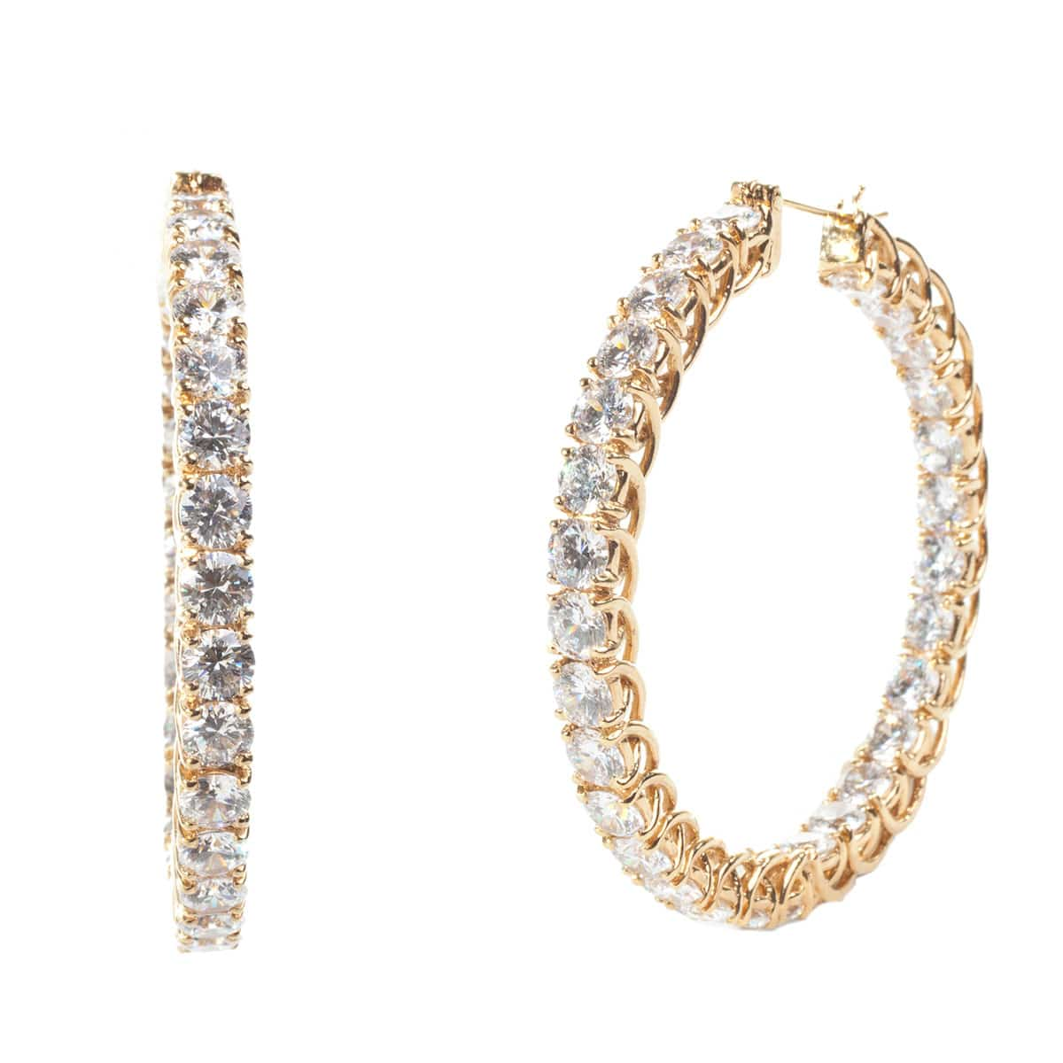 Diamond hoops that reveal diamonds on the inside and outside of the hoops. They look great for the office as well as an evening